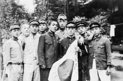 When Japanese men were drafted into service, their family and friends gathered to show their support. A small Japanese flag would be signed by the family with black ink. The flag was folded and carried securely beneath their clothing into war.